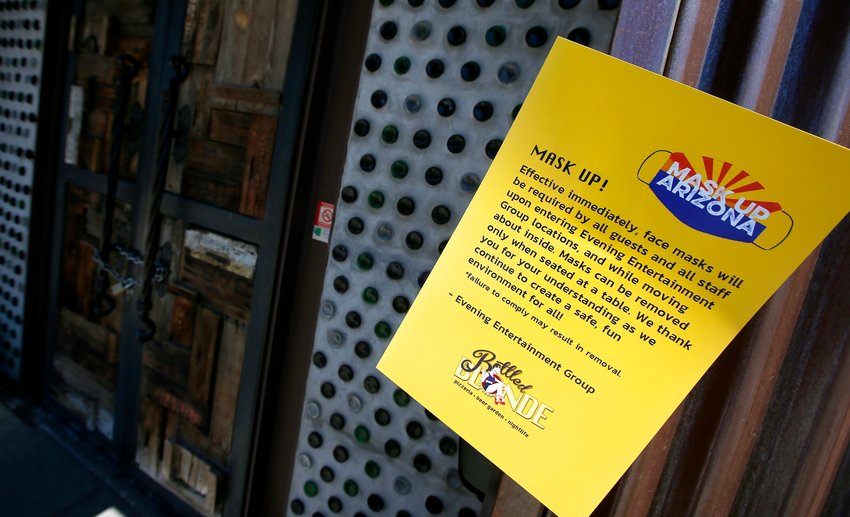 Bottled Blonde, one of the restaurant bars closed for the next 30 days due to the surge in coronavirus cases, has a posted rules sign but also has a padlocked front door Tuesday, June 30, 2020, in Scottsdale, Arizona.