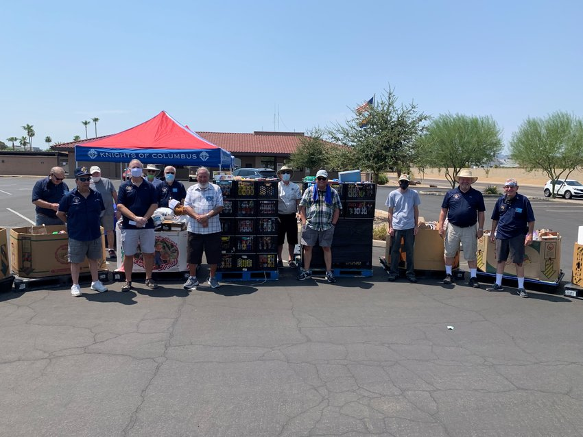 Volunteers for the Knights of Columbus food drive included, from left, Joe Kowolokowski, Dave Lara, Bob Conen, John Melcarek, Dick Eisenmenger, Dennis Dionne, Joe Shanks, Rick Mahan, Albert Dailey, Roger Lipp, Mike Hug and Ron Rinder. Missing from photo are Don King, Jake Kluch and Mike Ward.