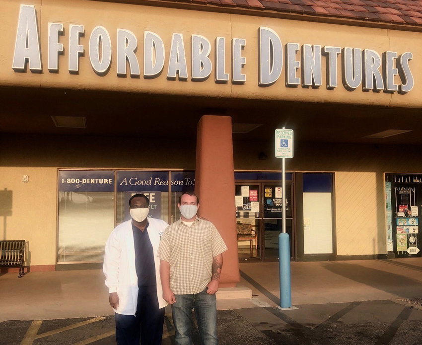 Dr. Sibera Brannon with Austin Quigley outside the dental office where the Youngtown resident received his permanent dentures.