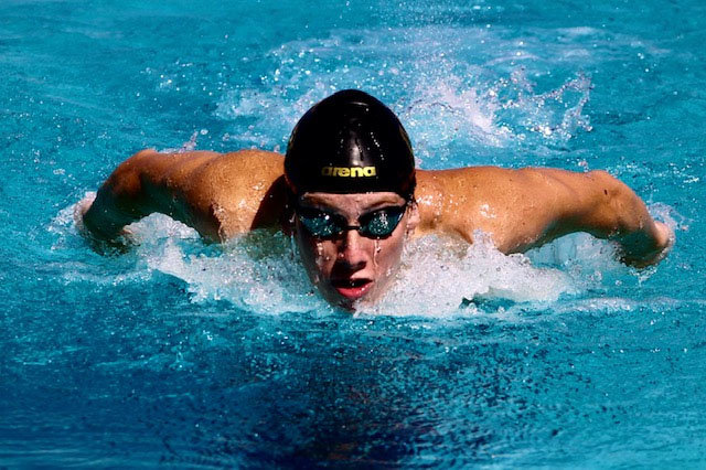 Sunrise Mountain senior swimmer Daniel Matheson competes in a butterfly race during the Mustangs' Oct. 8 home meet against Mountain Ridge.