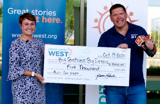 Credit Union West president and CEO Karen Roch presents $5,000 in support of Paul's Car Wash.
