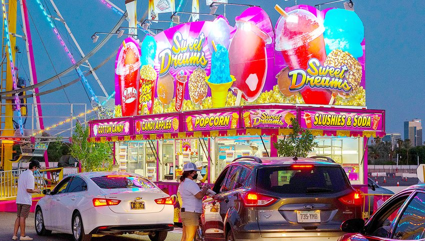 Lines of cars wend their way through the Arizona State Fair Drive-Thru Fair Food event at the Arizona State Fair Grounds in Phoenix, a special opportunity this year, as the fair is canceled because of the ongoing COVID-19 public health crisis. Fair food fans get one more bite of the no-admission event this weekend — Thursday, Friday and Sunday only — and an timely opportunity to donate canned goods to help those in need.