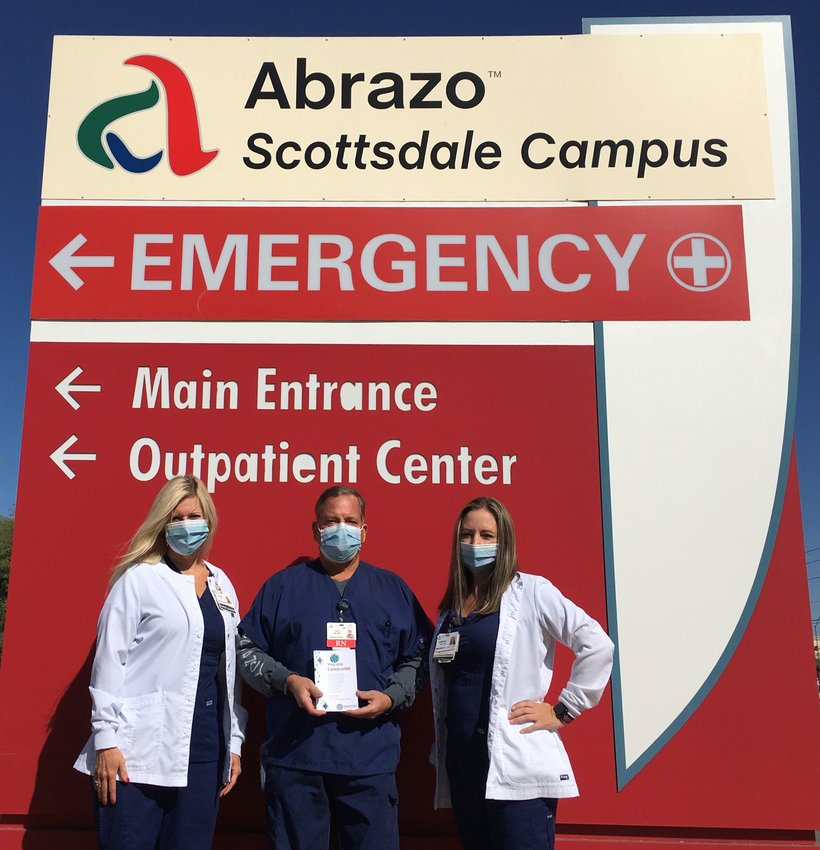 Abrazo Scottsdale Campus ER Nurse Tom Bretz, RN (center) was recognized for 25 years as a Certified Emergency Nurse. Pictured with Mr. Bretz are hospital Chief Nursing Officer Wendi Sears and Emergency Department Director Sarah Bird.