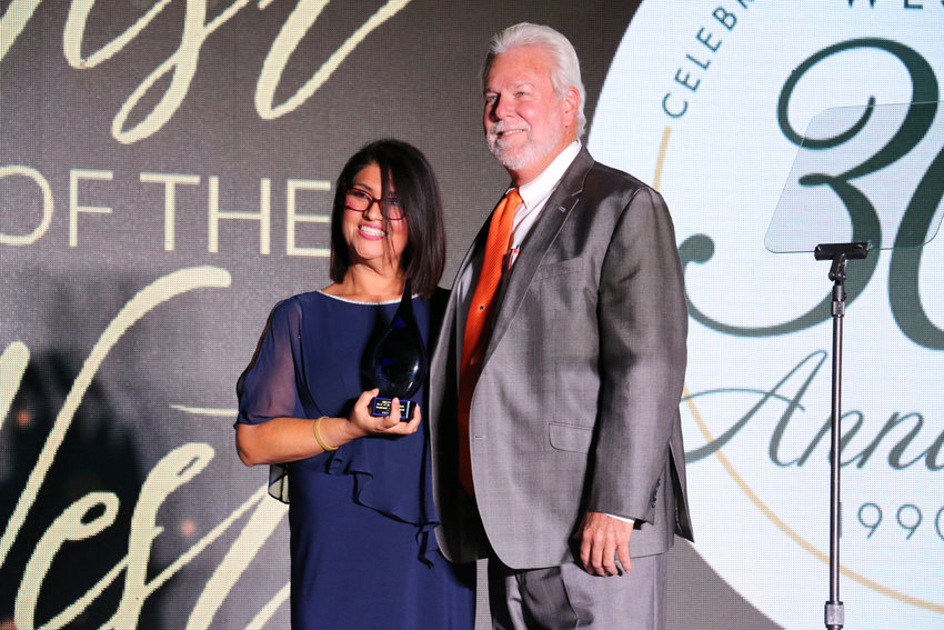 Phoenix Vice Mayor Betty Guardado and West-MEC Superintendent Greg Donovan smile after West-MEC was given the West Valley Regional Advancement Award Oct. 22. Guardado nominated the career technical education district, which has a campus in Surprise.