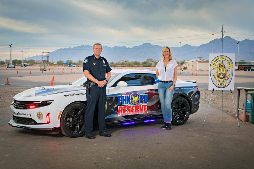 The Phoenix Police Reserve Foundation donated four cars to the city's police department, including this specially wrapped Camaro.