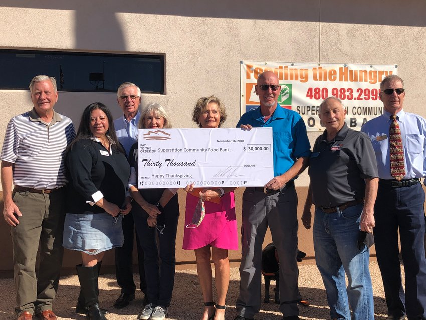 The recent check presentation includes representatives from the Superstition Community Food Bank, Superstition Mountain Golf and Country Club and the Apache Junction community.