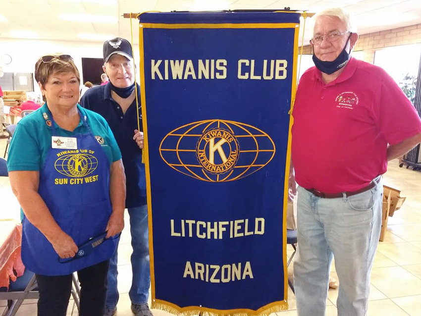 David Schwake, right, was at Luke Air Force Base with fellow Kiwanis International members Nov. 19, passing out Thanksgiving meal boxes to 153 families.
