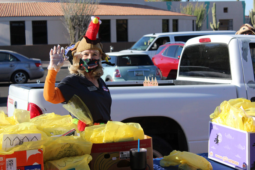 Sharon Allison-Brown, a Superstition Community Food Bank board member. Volunteers distributed 500 Thanksgiving meals to kick off Superstition Community Food Bank's holiday food distribution program. More than 2,000 holiday meals are expected to be given away by the end of the holiday season.