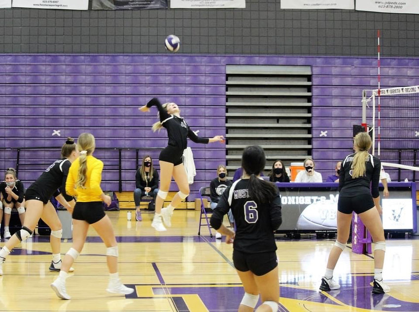 Sunrise Mountain sophomore setter Taryn Davis reaches back for a crosscourt attack during the Mustangs' 5A volleyball semifinal loss to Cave Creek Cactus Shadows Nov. 19.