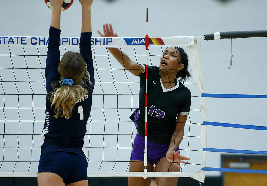 Millennium sophomore outside hitter Eryn Jones hammers a point past the defense of Cactus Shadows sophomore Sidney Parks during the 5A state championship volleyball match on Saturday Nov. 21, 2020.