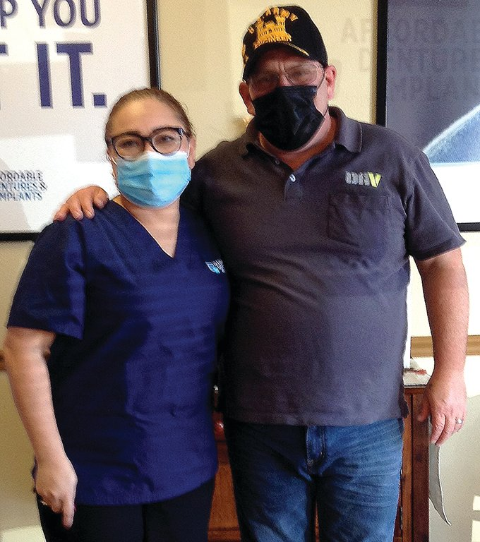 James Geary poses with Karen Corea from the Affordable Dentures & Implants Sun City team.