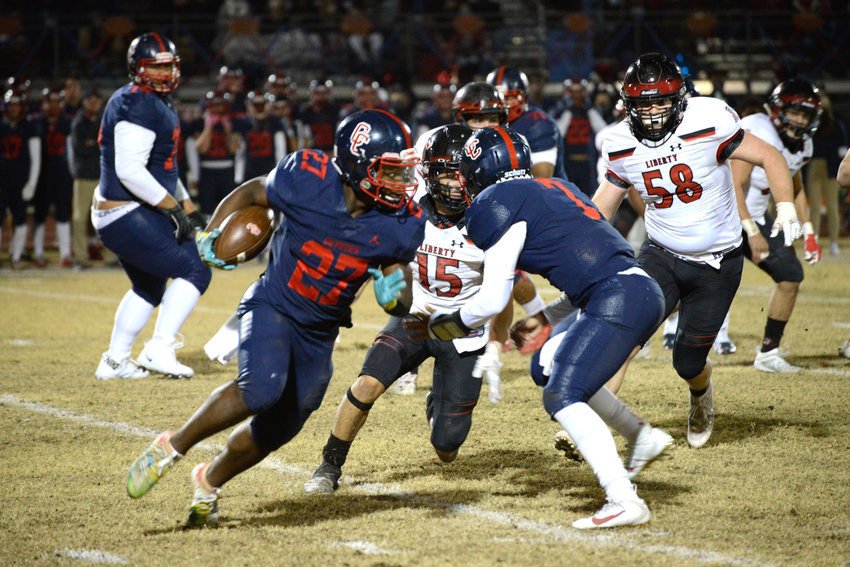 Centennial sophomore tailback Kavaughn Clark runs around the end during a Nov. 27, 2020, Open Division quarterfinal against Liberty. Clark and fellow tailback James Scott are back, bringing a combined 1,500 rushing yards with them.