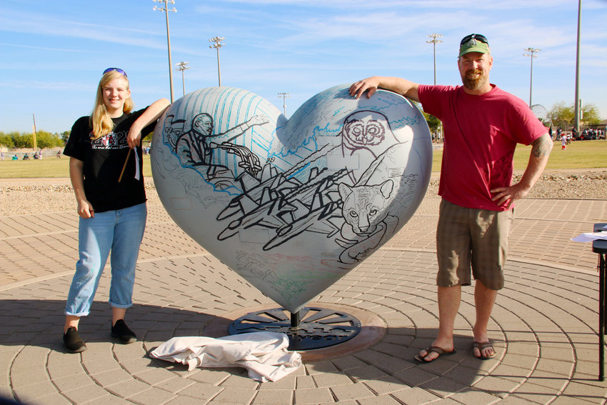 Addison, left, and Adam Turner chose the decade of the 1960s for their HeART of Goodyear mural project.