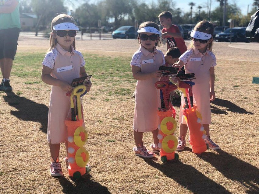 A trio of Itty Open golfers check out their gear in Goodyear in 2018