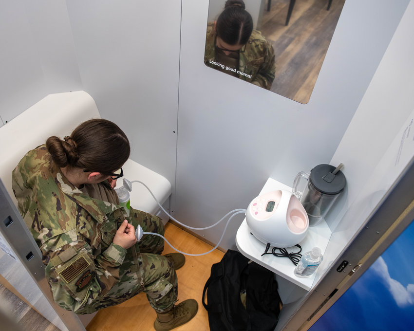 Senior Airman Caitlin Diaz-Gorsi, 56th Fighter Wing public affairs specialist and lactating mother, pumps breastmilk in a Mamava Lactation Pod at Luke Air Force Base.