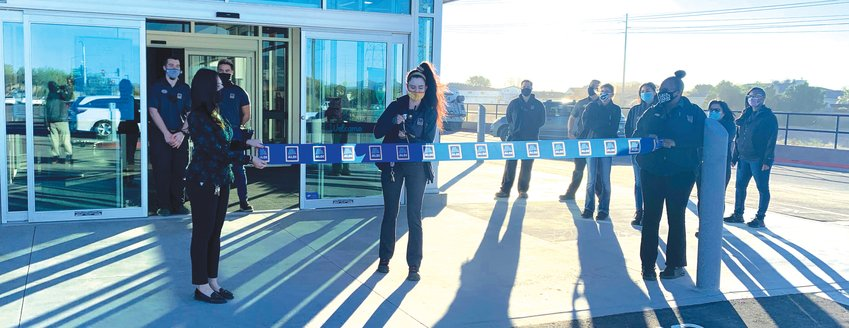 Store manager Stephanie Wilson performs a ribbon cutting for the newest Aldi location, 26455 N. Lake Pleasant Parkway, Dec. 15.