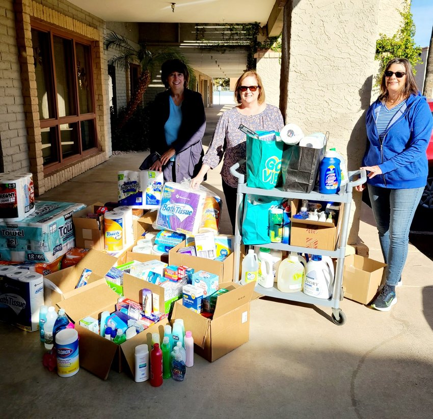 Pictured with the donations from the club are Joanne Grady, outreach coordinator, The Singletons, Tammy Ruocco, vice president, NextGen, and Lorna Fisher, president, NextGen. [Submitted photo]