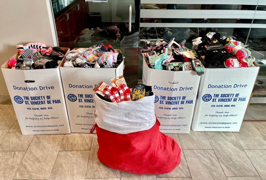 P.B. Bell's employees and vendors were able to donate more than 3,200 pairs of socks to those in need.
