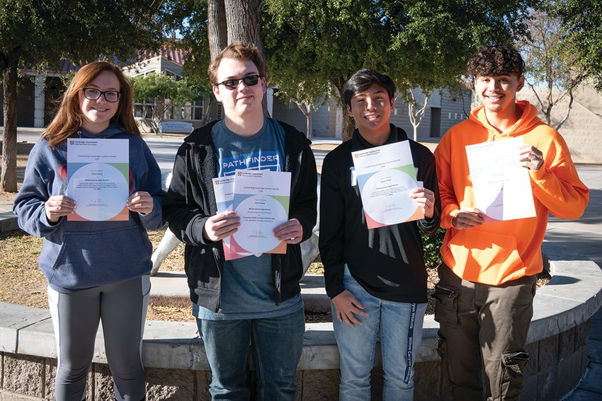 Emily Poling, Orion Evans, Augusto Palo, and Tristan Alvarado received the Cambridge Scholar Award with Merit for earning high marks on exams from June 2019.