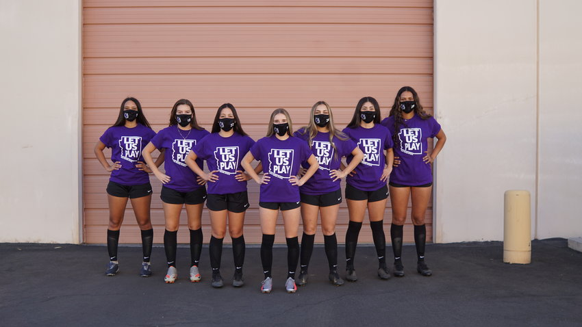 "Seniors on the Millennium High School girls soccer team wear shirts stating ""Let Us Play,"" after the AIA executive board voted to cancel the winter sports season Jan. 8. On Jan. 12, the board reversed course and voted to reinstate winter sports."