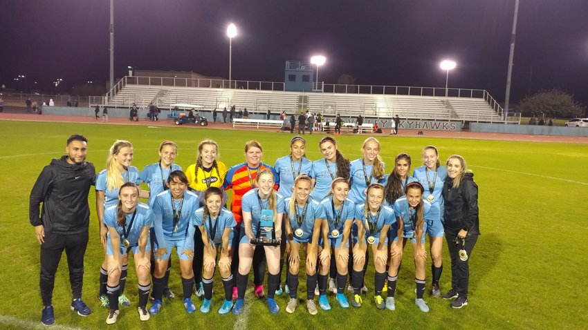 The Estrella Foothills girls soccer team poses with its trophy after winning the 21at annual Deer Valley High School Girls Soccer Invitational in late 2019.