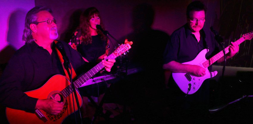 Gaylan and Em Taylor and Steve Godfrey, known as the Couple Next Door, will perform regularly as the Friday night happy hour band at The Chicken Ranch, 14051 W. Grand Ave.