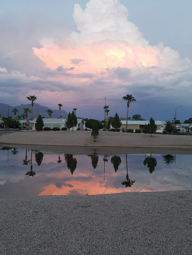 """That's looking east, the sky is a reflection of the sunset in the west, and in the water is a reflection of that reflection,' Apache Junction photographer Don Thompson said."