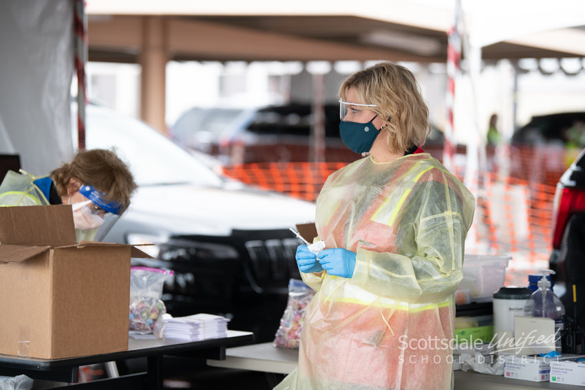 SUSD volunteers including Acting Chief Financial Officer Shannon Crosier, Dr. Menzel, superintendent, COVID Specialist Whitney Jennings served as greeters and school nurses helped administer the shots at the drive-thru clinic.