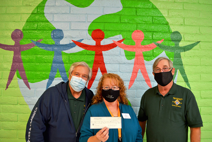 From left are Community Director Steven Ezyk, Boys and Girls Club Director Angela Davis and Grand Knight Matthew Campbell.