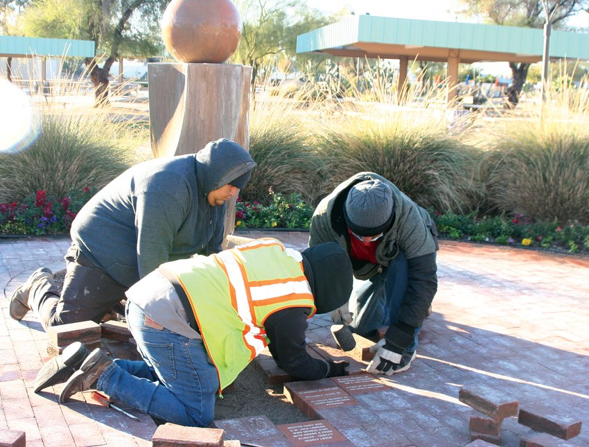 Landscapers with the Recreation Centers of Sun City West Raul Rodriguez, Jonathan Juarez and Freddy Rodriguez laid new bricks at the Memorial Garden at Beardsley Park, 20011 N. 128th Ave.
