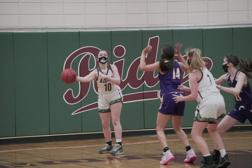 Mountain Ridge sophomore guard Alyssa Fraulino tries to inbound the ball to junior forward Alison Roskelley (#1) while facing the pressure defense of Sunrise Mountain sophomore forward Reena Bhakta (#14) and senior guard Julie Diveney (#23).