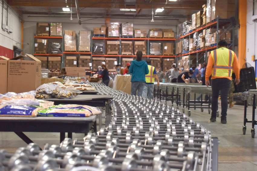 St. Mary's Food Bank delivers thousands of pounds of food to people in metro Phoenix and elsewhere. The process starts here, where workers assemble boxes and add such nonperishables as pasta and rice donated by individuals and companies. [Kelly Richmond/Cronkite News]
