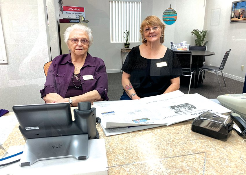 PORA, 13815 W Camino Del Sol, volunteers Marge Spencer and Annie Hodgson assist residents calling in for information on various topics including the COVID-19 vaccine.