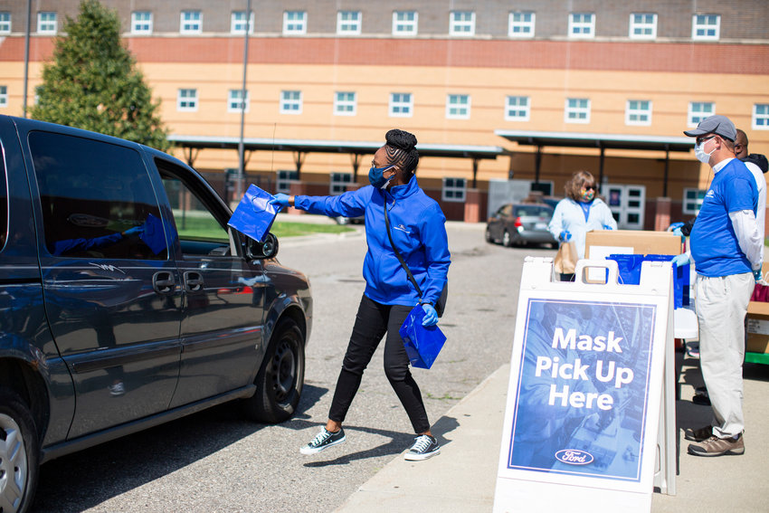 Residents of on Detroit's east side picked up thousands of free masks Friday at Fisher Magnet Upper Academy, home of the Ford Resource and Engagement Center. Ford Motor Company Fund and more than 35 Southeast Michigan Ford dealers teamed up to hand out 300,000 free masks to residents and nonprofits. Ford Fund, the automaker's philanthropic arm, is delivering millions of free medical-grade masks to residents, nonprofit partners, state and local officials, schools, community groups and dealerships across the U.S. Also this week, Ford Fund donated 500,000 masks to the Detroit Public School District. The donation brings Ford Fund's total mask donations to Detroit school children to nearly 1 million. PHOTO BY: Charlotte Smith, Ford Motor Company