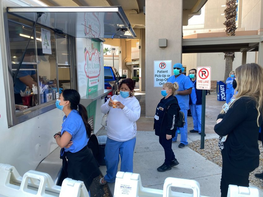 Abrazo West Campus staff and providers line up for free ice cream treats this week in recognition of the teams who have been by the bedsides of patients in the year since the COVID-19 pandemic began.