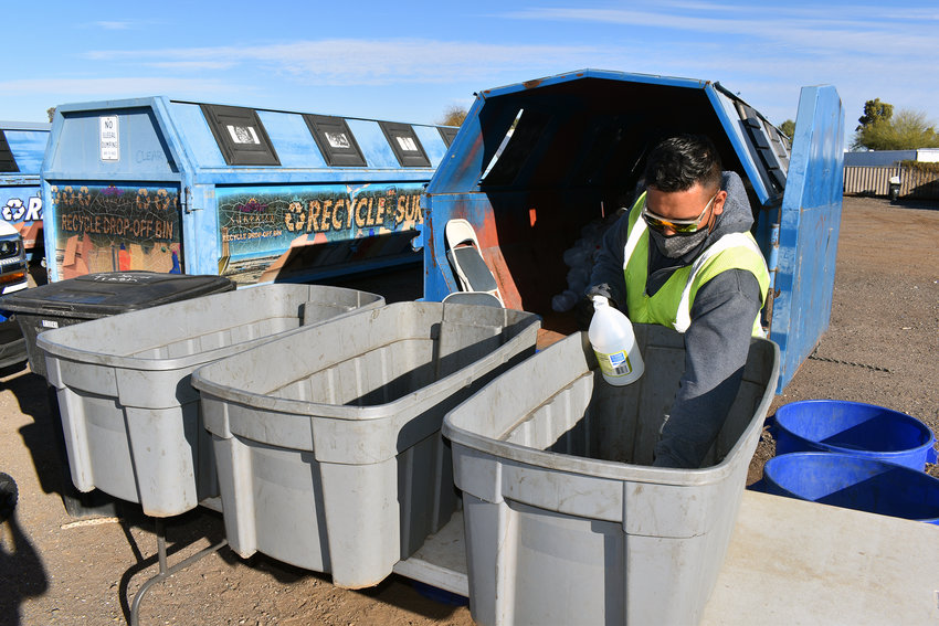 Gus Pedroza, a solid waste inspector for the city of Surprise, sorts out recycling items a resident dropped off one recent morning. The city gets about 500 cars a month coming through its dropoff site near Bell and Litchfield roads.