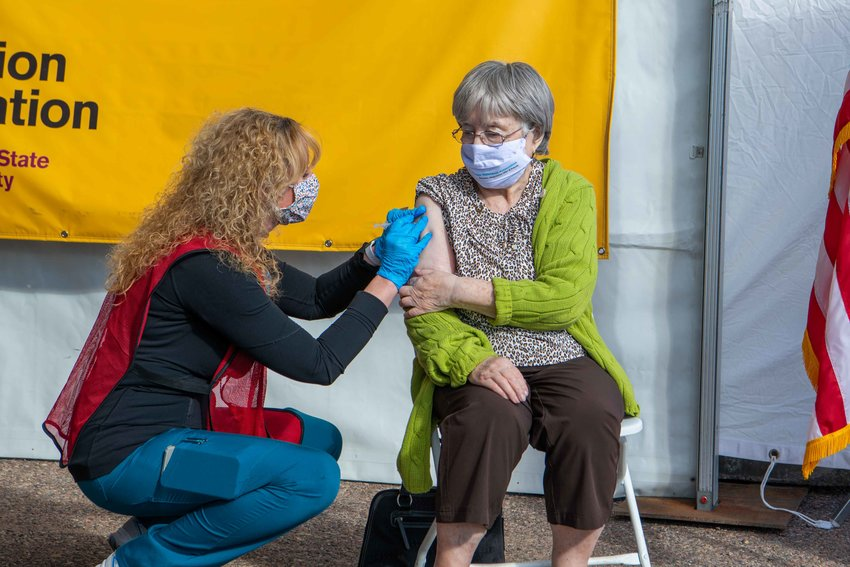 Frieda Allweiss (green sweater) receives a COVID-19 vaccination from Dr. Cara Christ, Arizona Department of Health Services Director on Feb. 12 at the Phoenix Municipal Stadium in Phoenix. The event was helped organized by Jewish Family and Children's Service.