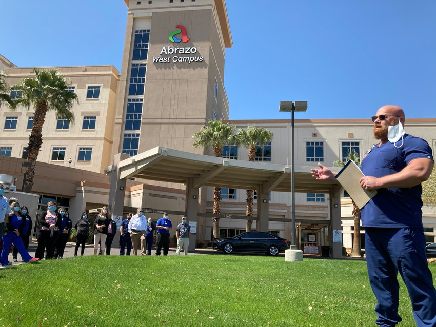Abrazo West Campus ICU Director Jerry Lawlor speaks during the hospital's COVID-19 remembrance March 19.