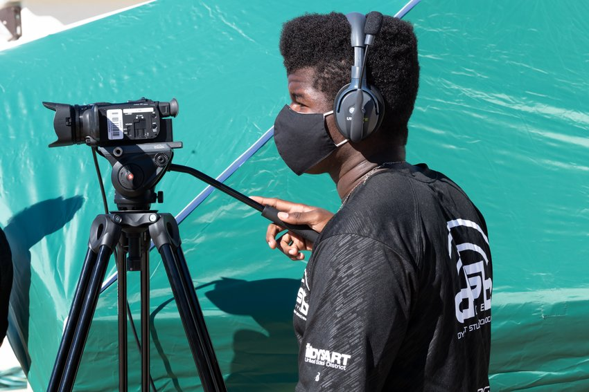 Jessiah Nelson, junior at Willow Canyon High School operates a camera for DSB Live.