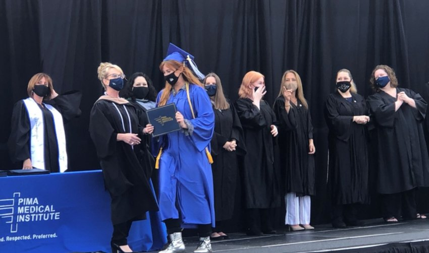 Staff at Pima Medical Institute's Phoenix Campus got creative with space at its recent graduation.  Families were able to watch the graduation from the comfort of their vehicles while graduates lined up with their respective program.