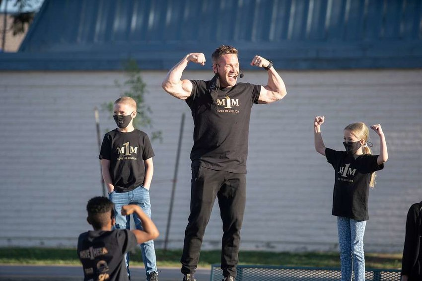 Chris Powell leads students in Move One Million movements at Stevenson Elementary on March 29.