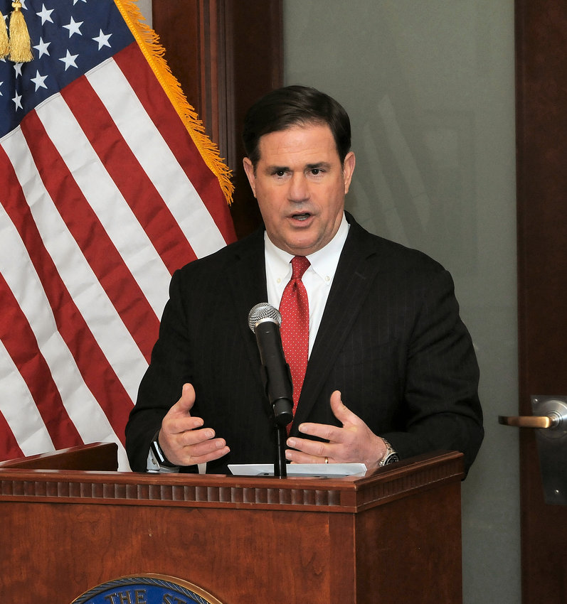 Gov. Doug Ducey discusses the potential repercussions of new Arizona election laws at a Thursday news conference.