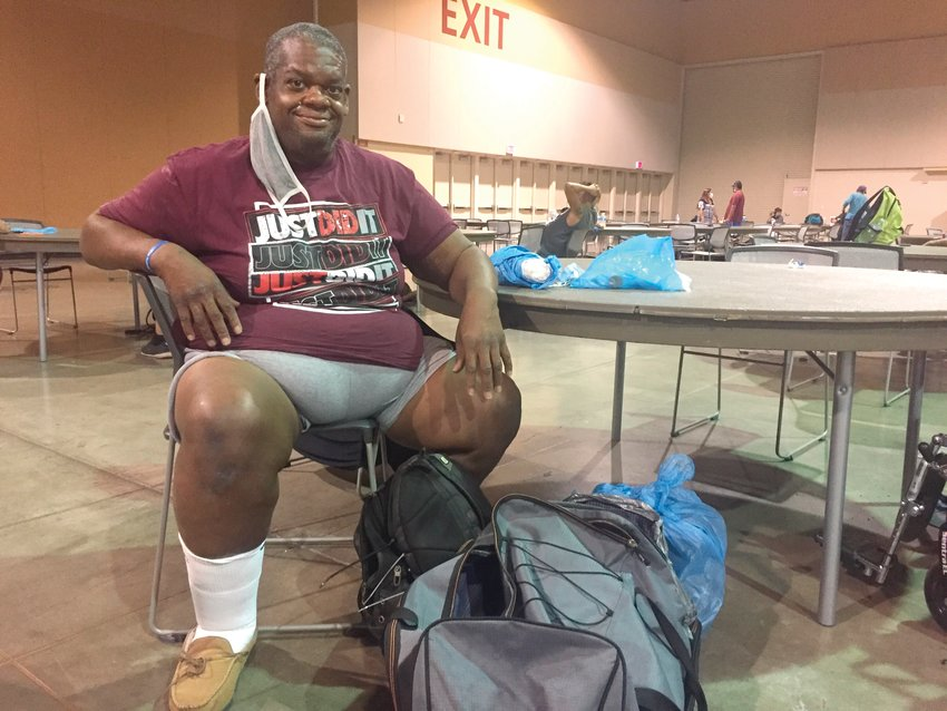 Gary Goodman, 47, rests at the heat respite center at the Phoenix Convention Center on Sept. 1, 2020. Mr. Goodman tries to arrive at the center around 9 a.m. and stay until 6 p.m. when he can check into an overnight shelter. [Brian P.D. Hannon/The Associated Press]