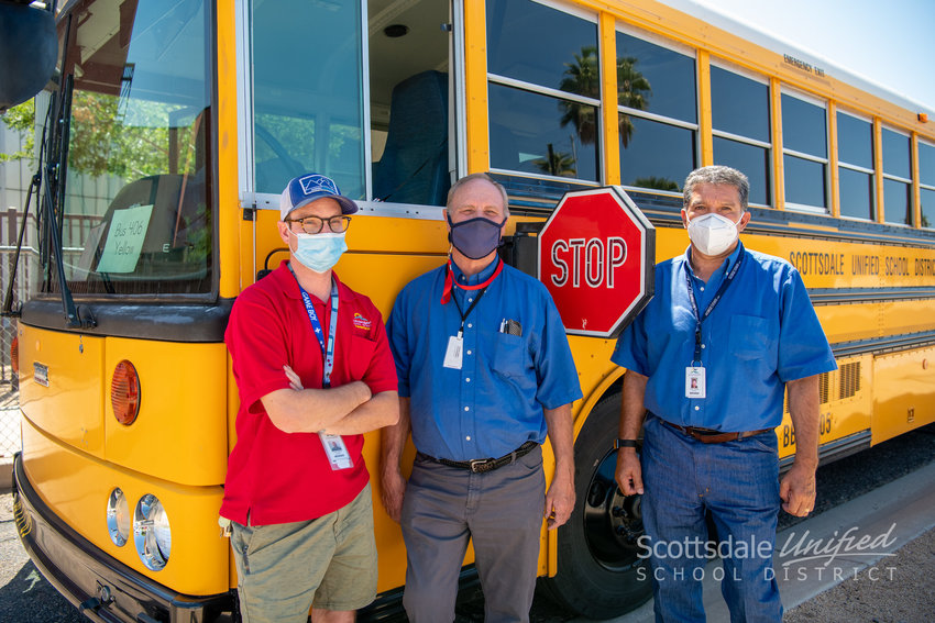 From left, Scottsdale Unified School District bus drivers Shawn Barker, Douglas Hammond and Sergio Pereda ensure Mohave Middle School students get to and from school safely each day. The district is celebrating School Bus Driver Appreciation Day and its 80 bus drivers on April 27.