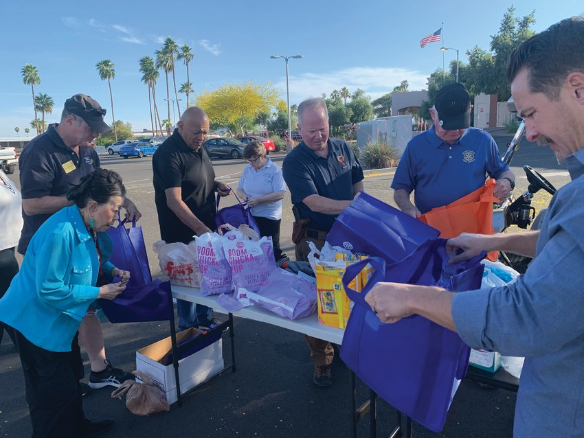 Mesa Sunrise Rotary volunteers fill gift bags for Christian Care Cottonwood Assisted Living residents.