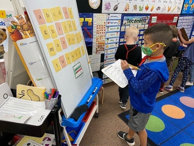 A kindergarten student in the  Peoria Unified School District learns the alphabet.