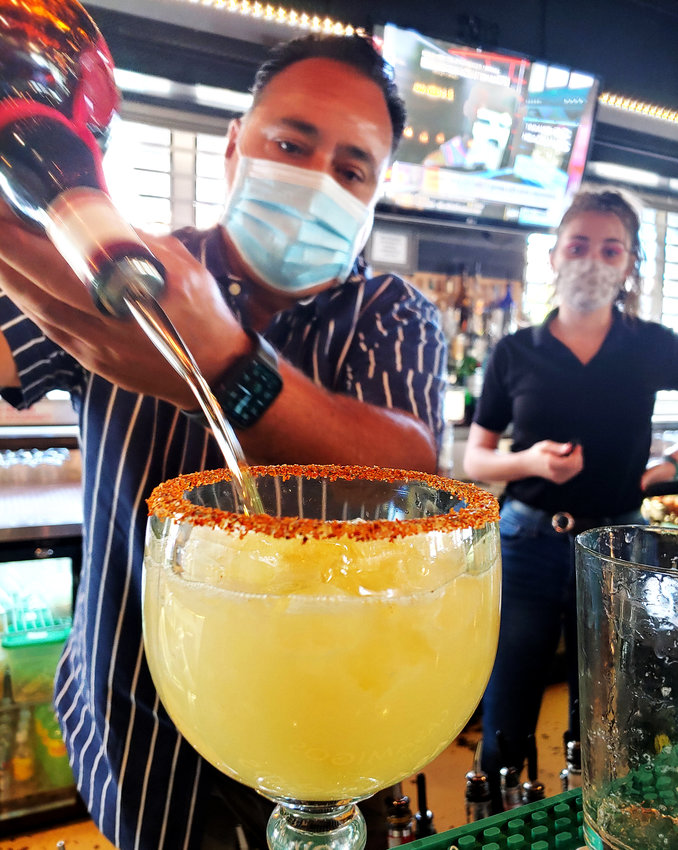 David Borrego mixes up a fresh Urban Margarita at his Glendale Mexican restaurant on May 4.