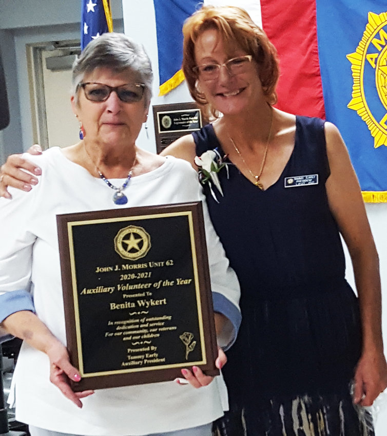 Benita Wykert, Volunteer of the Year, and president Tammy Early. [