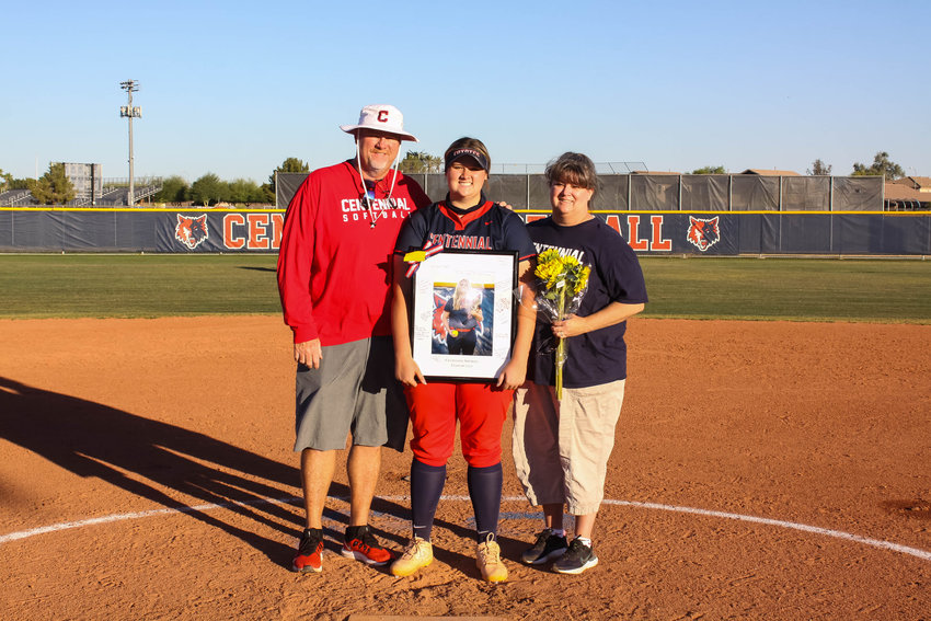 Centennial senior pitcher Meghan Golden is honored as part of the Coyotes' senior night April 29 in Peoria, along with her parents, Jason and Erin.