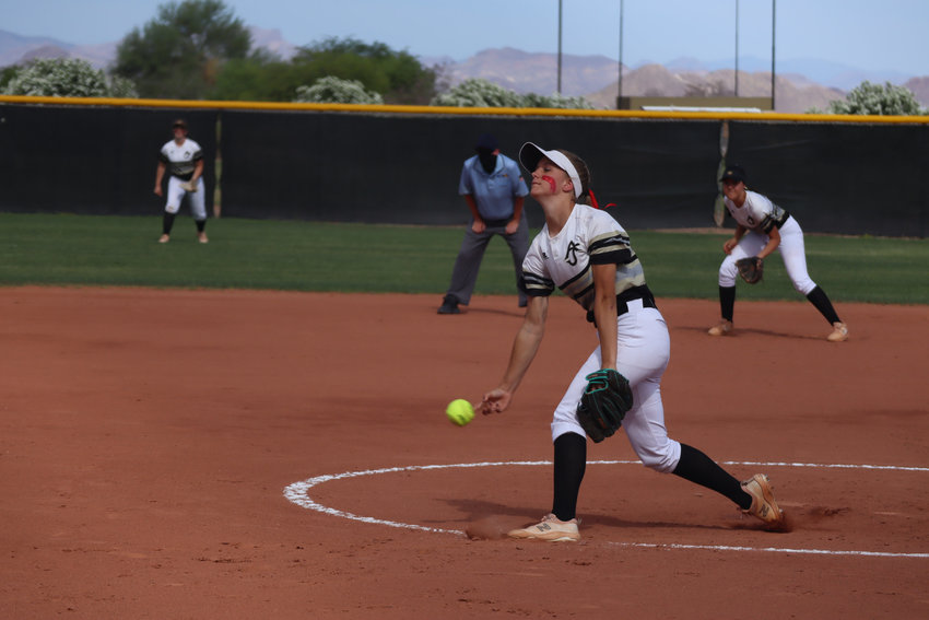 Senior Tristen Greer pitching for the Apache Junction High School softball team.
